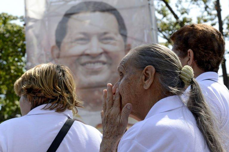 Supporters of Hugo Chavez are seen outside of the Military Hospital in Caracas on March 5, 2013. Venezuela has plunged deeper into an uncertain future after the cancer-stricken president took a turn for the worse, hit by a severe infection and breathing problems