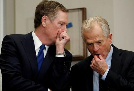 FILE PHOTO: Robert Lighthizer, United States Trade Representative, and Peter Navarro chat while they wait for U.S. President Donald Trump to arrive, at the White House in Washington