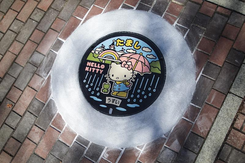 Japan's sewerage industry has found a way to clean up its dirty and smelly image: elaborately designed and colourful manhole covers with 12,000 local varieties nationwide -- including, of course, a Hello Kitty design (AFP Photo/Behrouz MEHRI)