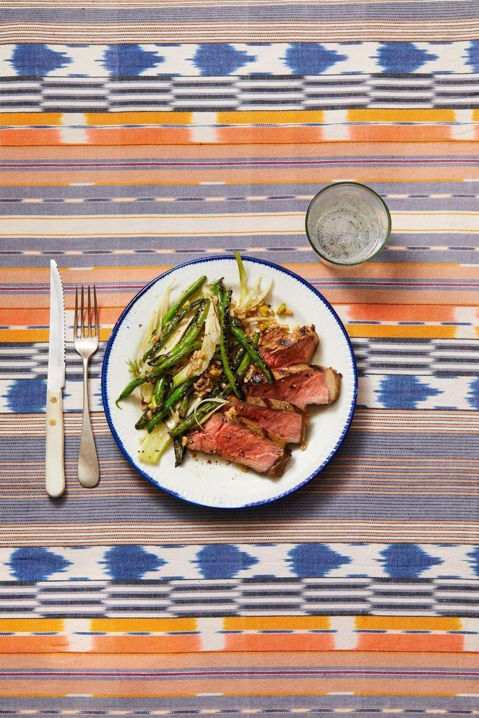 """<p>Lucky enough to have access to a grill all year long? Perfectly charred steak is ready in just 12 minutes, just enough time for you to <a href=""""https://www.goodhousekeeping.com/food-recipes/cooking/a27557917/what-is-farro/"""" rel=""""nofollow noopener"""" target=""""_blank"""" data-ylk=""""slk:boil farro"""" class=""""link rapid-noclick-resp"""">boil farro</a> for the whole fam.</p><p><em><a href=""""https://www.goodhousekeeping.com/food-recipes/a28611907/steak-with-grilled-green-beans-fennel-and-farro-recipe/"""" rel=""""nofollow noopener"""" target=""""_blank"""" data-ylk=""""slk:Get the recipe for Steak With Grilled Green Beans, Fennel & Farro »"""" class=""""link rapid-noclick-resp"""">Get the recipe for Steak With Grilled Green Beans, Fennel & Farro »</a></em></p>"""