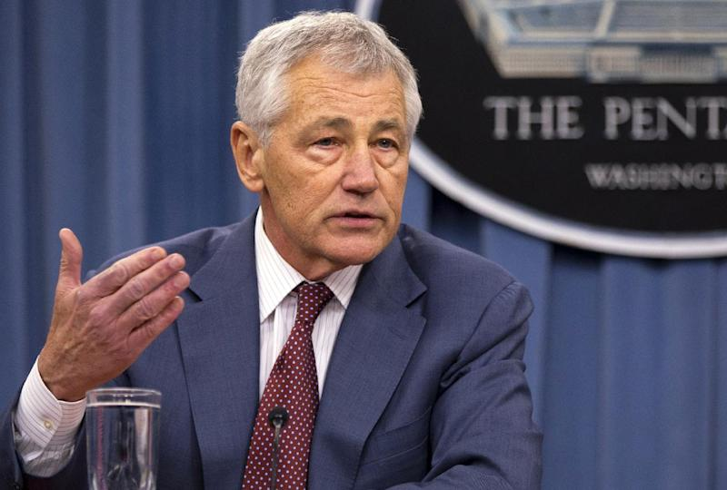 """FILE - In this March 28, 2013 file photo, Defense Secretary Chuck Hagel speaks at the Pentagon. Hagel said Thursday that U.S. intelligence has concluded """"with some degree of varying confidence,"""" that the Syrian government has used sarin gas as a weapon in its 2-year-old civil war,  (AP Photo/Jacquelyn Martin, File)"""