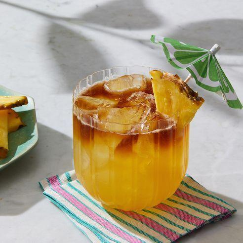 """<p>In 1944, Victor """"Trader Vic"""" Bergeron, founder of the international Polynesian restaurant chain (yes, <em>that</em> Trader Vic) served his new tiki drink to friends visiting from Tahiti. One sip and it was declared """"Maitai'i roe a'e"""" (""""out of this world, the best,"""" in Tahitian).</p><p><em><a href=""""https://www.goodhousekeeping.com/food-recipes/a28579635/mai-tai-recipe/"""" rel=""""nofollow noopener"""" target=""""_blank"""" data-ylk=""""slk:Get the recipe for Classic Mai Tai »"""" class=""""link rapid-noclick-resp"""">Get the recipe for Classic Mai Tai »</a></em></p>"""
