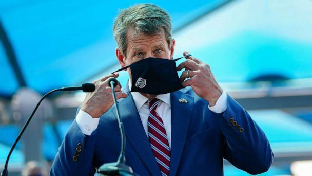 PHOTO: Georgia Gov. Brian Kemp puts on a mask after speaking at a press conference announcing statewide expanded COVID testing on Aug. 10, 2020 in Atlanta. (Elijah Nouvelage/Getty Images)