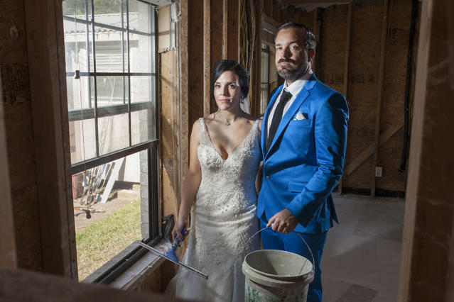 Shellie Schoellkopf and Robert Callaway pose for wedding photos in the Harvey-ravaged home of a friend. (Photo: Bryan Anderson/www.beautyinart.com)