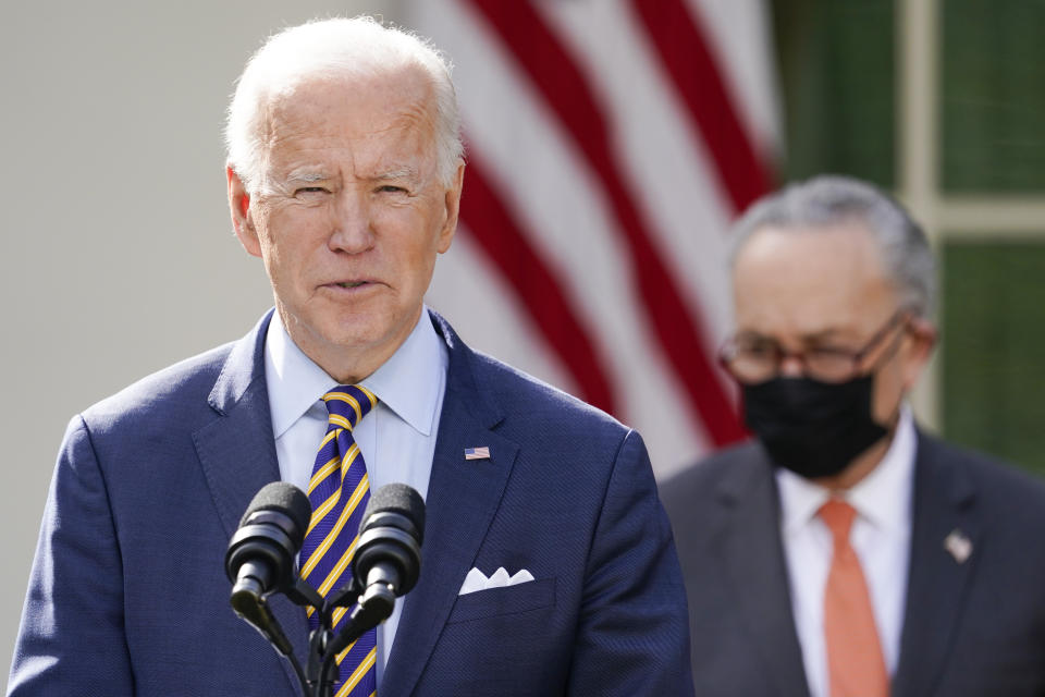 President Joe Biden speaks about the American Rescue Plan, a coronavirus relief package, in the Rose Garden of the White House, Friday, March 12, 2021, in Washington. Senate Majority Leader Chuck Schumer of N.Y., is at right. (AP Photo/Alex Brandon)