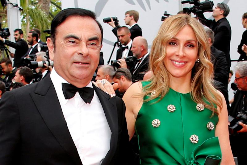 "70th Cannes Film Festival – Screening of the film ""L'Amant double"" (Amant Double) in competition - Red Carpet Arrivals - Cannes, France. 26/05/2017. Carlos Ghosn, Chairman and CEO of the Renault-Nissan Alliance, and his wife Carole pose. Picture taken May 26, 2017. REUTERS/Jean-Paul Pelissier"