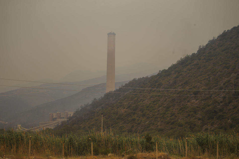 The Kemerkoy Power Plant, a coal-fueled power plant, in Milas, Mugla in southwest Turkey, Thursday, Aug. 5, 2021. A wildfire that reached the compound of a coal-fueled power plant in southwest Turkey and forced evacuations by boats and cars, was contained on Thursday after raging for some 11 hours, officials and media reports said. (AP Photo/Emre Tazegul)