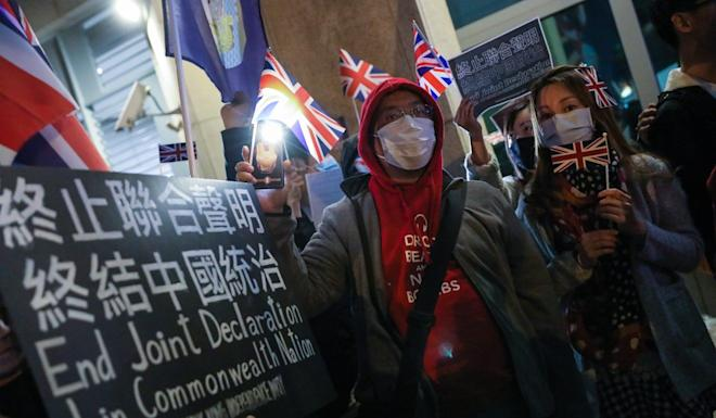 Activists take part in a rally outside the British Consulate in Admiralty on Wednesday. Photo: K.Y. Cheng