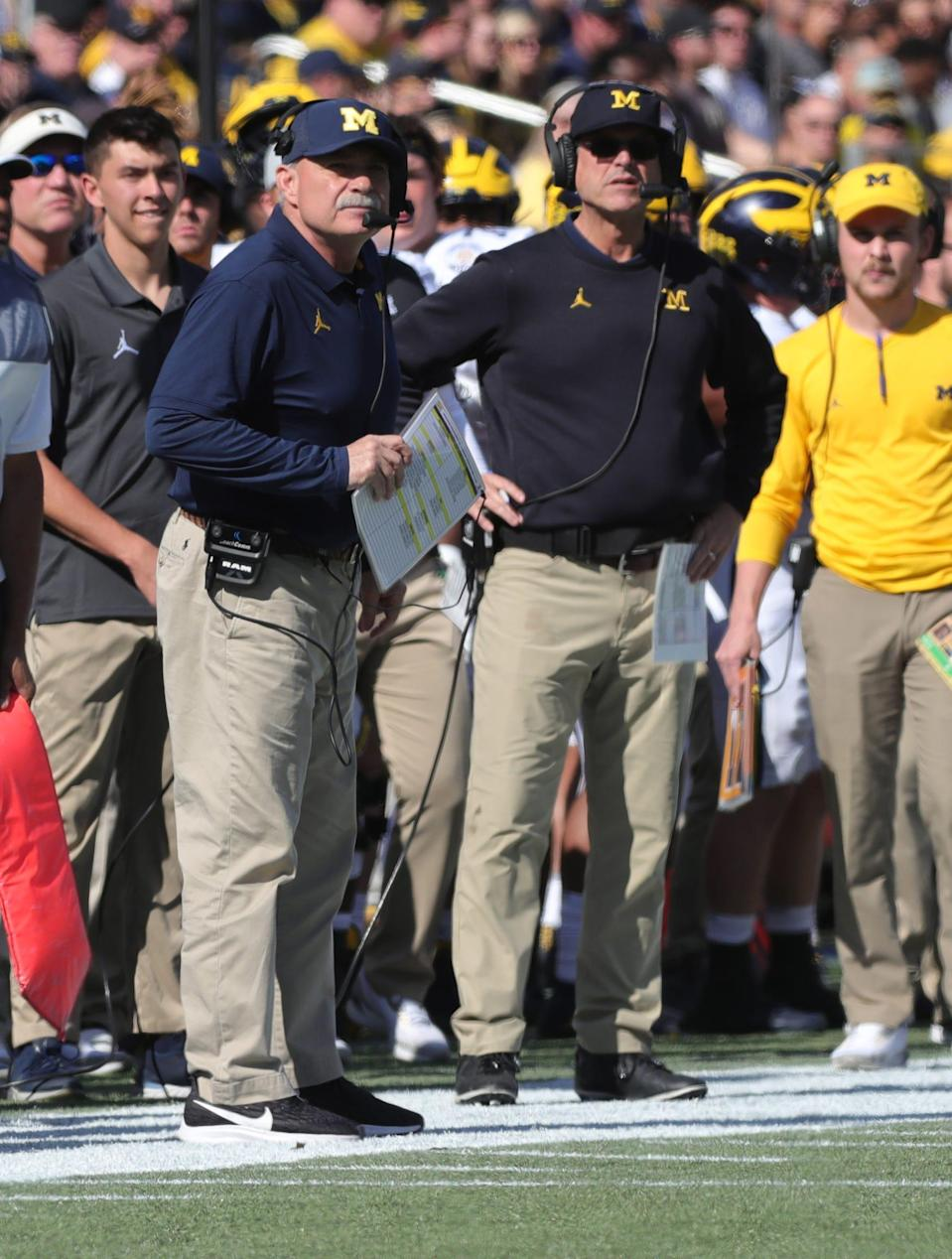 Michigan defensive coordinator Don Brown, left, and coach Jim Harbaugh, right, during the first half of the Citrus Bowl, Wednesday, Jan. 1, 2020 at Camping World Stadium in Orlando, Fla.