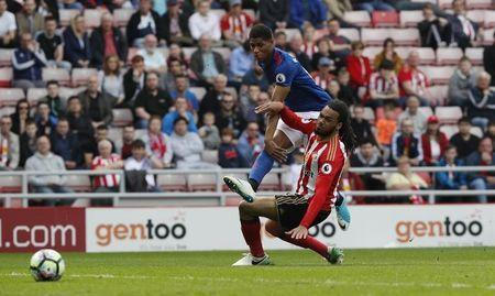 Britain Football Soccer - Sunderland v Manchester United - Premier League - Stadium of Light - 9/4/17 Manchester United's Marcus Rashford scores their third goal Reuters / Russell Cheyne Livepic