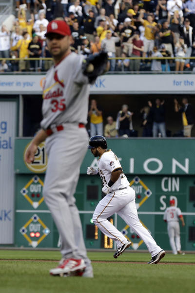Pittsburgh Pirates' Pedro Alvarez, right, rounds the bases after hitting a three-run home run off St. Louis Cardinals starting pitcher Jake Westbrook (35) during the first inning of a baseball game in Pittsburgh Monday, July 29, 2013. (AP Photo/Gene J. Puskar)