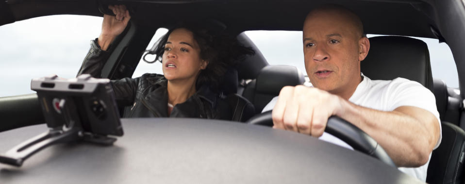 """This image released by Universal Pictures shows Michelle Rodriguez, left, and Vin Diesel in a scene from """"F9: The Fast Saga."""" (Giles Keyte/Universal Pictures via AP)"""