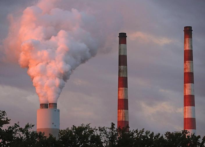 <p>Emissions spew out of a large stack at the coal-fired Morgantown Generating Station on October 10, 2017 in Newburg, Maryland.</p> (Mark Wilson / Getty Images)