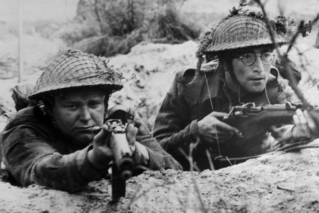 (Original Caption) Beatle John Lennon (right) and Roy Kinnear play members of a British Platoon caught up in World War II's north Africa campaign in United Artists' How I Won the War, directed by Richard Lester.