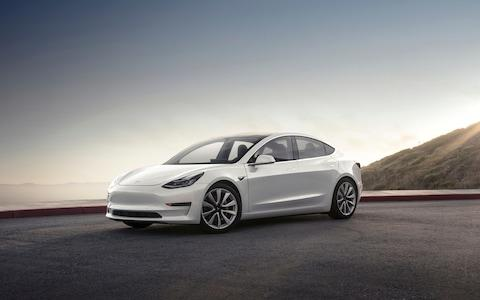 The Tesla Model 3, which the automaker has touted as its most affordable electric vehicle. - Credit: AP