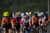 Riders compete during the women's cycling road race at the 2020 Summer Olympics, Sunday, July 25, 2021, in Oyama, Japan. (AP Photo/Christophe Ena)