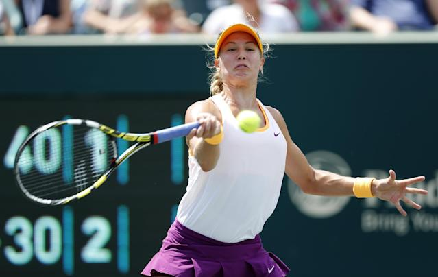 Eugenie Bouchard, of Canada, returns to Jelena Jankovic, of Serbia, during the Family Circle Cup tennis tournament in Charleston, S.C., Friday, April 4, 2014. (AP Photo/Mic Smith)