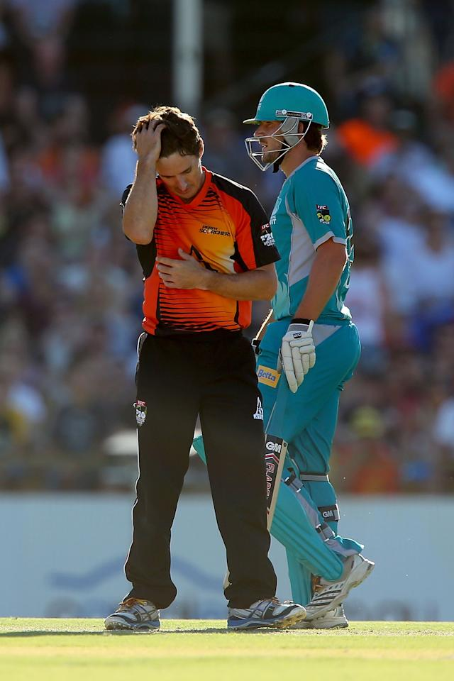 PERTH, AUSTRALIA - JANUARY 19: Brad Hogg of the Scorchers reacts after being hit for six during the Big Bash League final match between the Perth Scorchers and the Brisbane Heat at the WACA on January 19, 2013 in Perth, Australia.  (Photo by Paul Kane/Getty Images)