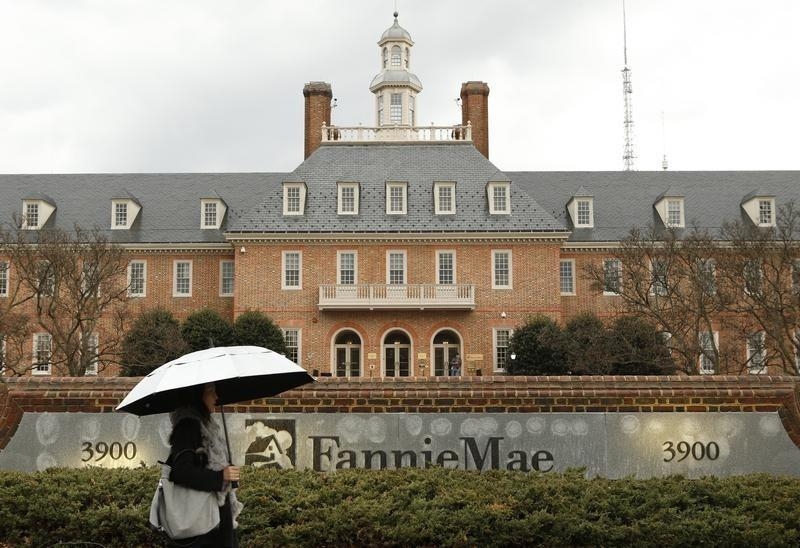 Woman walks past Fannie Mae in Washington