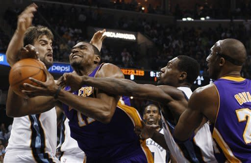 Memphis Grizzlies center Marc Gasol, left, and guard Tony Allen (9) defend Los Angeles Lakers center Andrew Bynum in the first half of an NBA basketball game Tuesday, March 13, 2012, in Memphis, Tenn. Lakers' Kobe Bryant is at right. (AP Photo/Alan Spearman)