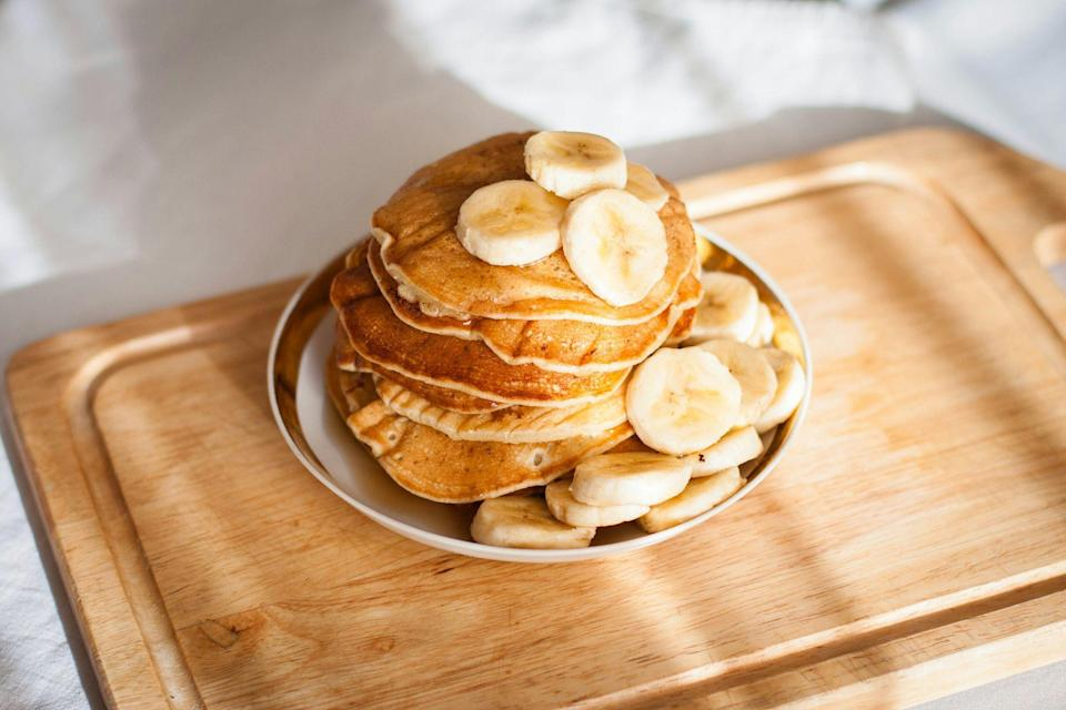 "<p>Protein pancakes for Pancake Day? We love to see it. This year, in the UK, Shrove Tuesday falls on February 16, 2021. And we've got a flipping great idea for celebrating (particularly if you've got some <a href=""https://www.menshealth.com/uk/building-muscle/a756812/mh-tried-tested-whey-protein/"" rel=""nofollow noopener"" target=""_blank"" data-ylk=""slk:protein powder"" class=""link rapid-noclick-resp"">protein powder</a> to use up). You'll likely know them as the ultimate post-workout breakfast but protein pancakes can make an appearance on their name-day, too! So, what are you waiting for? Put that shaker away and get out the whisk: it's mixing time.</p><h2 class=""body-h2"">Why is protein important?</h2><p>Protein, one of the three key macronutrients, helps your body build and repair muscle tissue following a workout. For the record, the <a href=""https://www.nhs.uk/live-well/eat-well/what-are-reference-intakes-on-food-labels/"" rel=""nofollow noopener"" target=""_blank"" data-ylk=""slk:NHS"" class=""link rapid-noclick-resp"">NHS</a> advises that women eat around 45g a day—the equivalent of three and a half eggs, two and a half salmon fillets or five portions of lentils. </p><p>If you exercise a lot this number should be higher.</p><h2 class=""body-h2"">Why should you make your own protein pancakes?</h2><p>It's worth remembering that making your pancakes – of any kind – from scratch will help you avoid the store-bought ones rammed full of sugar and added nasties. And let's be honest, they're not exactly tricky to make. Flour, baking powder, salt, sugar, butter, milk and eggs usually make up the core ingredients. Throw a scoop of protein powder into the mix and you'll be serving them up in no time. If you prefer a more <a href=""https://www.menshealth.com/uk/fitness/a34666796/joe-wicks-home-workout-motivation/"" rel=""nofollow noopener"" target=""_blank"" data-ylk=""slk:Joe Wicks'"" class=""link rapid-noclick-resp"">Joe Wicks'</a> approach, grab a banana, two eggs and some whey or <a href=""https://www.menshealth.com/uk/nutrition/a25932141/best-vegan-protein-powder/"" rel=""nofollow noopener"" target=""_blank"" data-ylk=""slk:vegan protein powder"" class=""link rapid-noclick-resp"">vegan protein powder</a> and you're GTG. It literally could not be more simple. </p><p>Looking for stacks of inspiration? We've whipped up the web for 25 sweet protein pancake recipe ideas just for you: including Madeleine Shaw's cinnamon and maple varieties and The Food Medic's blueberry and banana creation. Because there's more to great toppings than a tub of Nutella. From fresh fruit to peanut butter and honey, give yourself some options. Perhaps your first stack has a different topping combo to your second – you're in charge! </p><p> So, if you want to supercharge your protein pancakes, read on. We've got you covered this pancake day! </p>"