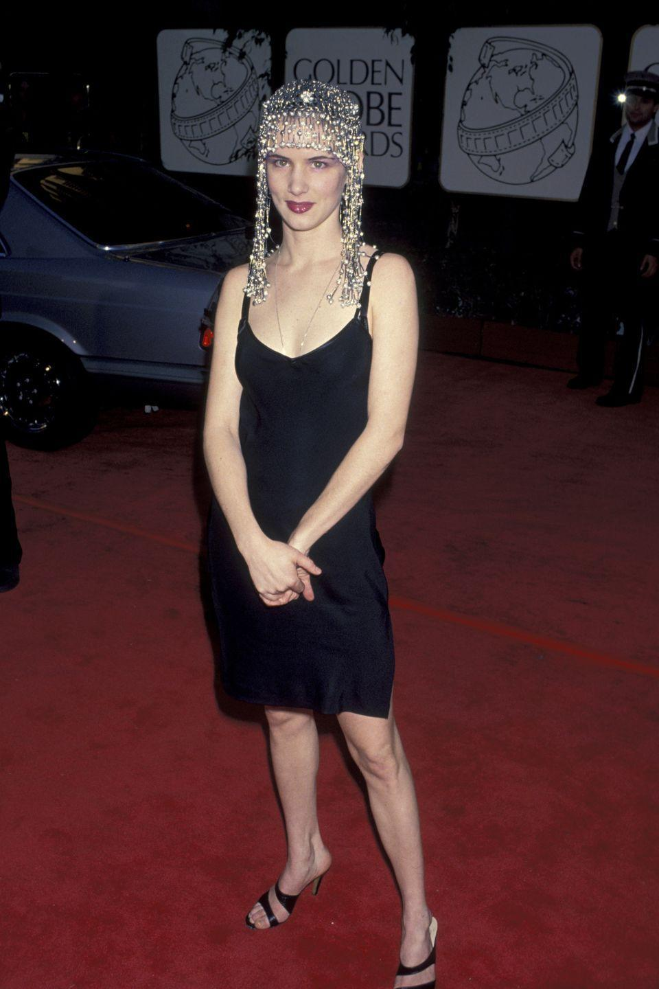 <p>The LBD was too simple for Lewis in 1994, so she added in a rather ornate headpiece.</p>