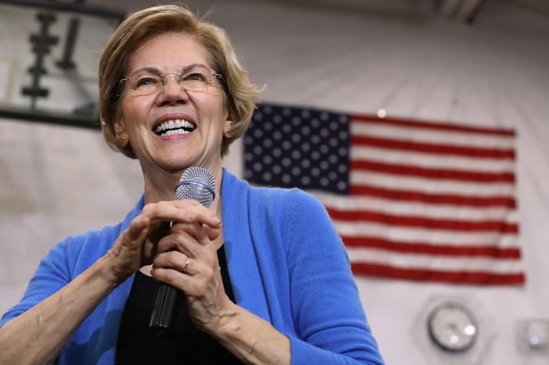 Democratic presidential candidate Sen. Elizabeth Warren (D-MA) in front of an American flag at a campaign rally at West High School on February 01, 2020 in Iowa City.