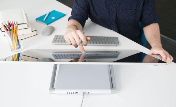 """<img alt=""""""""/><p>For the two weeks that the <a rel=""""nofollow"""" href=""""http://mashable.com/2016/10/26/microsoft-surface-studio-dial-hands-on/"""">Microsoft Surface Studio</a> sat at my desk, it attracted a lot of attention. I'm an illustrator and I work with a lot of other creatives, and artists <em>love</em> to look at something beautiful. There were plenty of """"Oohs"""" and """"Aahs,"""" and the beautiful simplicity of the device was demonstrated when, for about 15 minutes, five co-workers gathered around my desk as we went on a tour of the world via Google Maps.</p> <div><p>SEE ALSO: <a rel=""""nofollow"""" href=""""http://mashable.com/2017/01/06/dell-canvas/"""">Dell Canvas gives you Surface Studio abilities without the luxury price tag</a></p></div> <p>Navigating a 3D satellite view of New York City became a magical experience. Swiping a single finger on the screen allowed for rotating vistas that looked incredible. Was this a high point of artistic achievement? No. Was it insanely fun and beautiful, just because it was on the Studio? Yep.</p> <p><img title=""""3D Google Maps on the Surface Studio is an insanely fun and beautiful experience."""" alt=""""3D Google Maps on the Surface Studio is an insanely fun and beautiful experience.""""></p> <p>3D Google Maps on the Surface Studio is an insanely fun and beautiful experience.</p><div><p>Image:  Lili Sams/Mashable</p></div><p>Let me back up for minute: I'm <em>Mashable</em>'s senior illustrator — my job is to create the art and graphics that accompany our stories on our website and across our various social channels. In other words, I'm exactly the kind of person Microsoft is trying to appeal to with the Surface Studio, the company's sleek and powerful all-in-one PC.</p> <p>In a splashy press event last fall, Microsoft unveiled the Surface Studio and showed off its <a rel=""""nofollow"""" href=""""http://mashable.com/2016/10/26/microsoft-dial-surface-studiopc/"""">arsenal of tools and toys</a> for drawing, drafting and painting on its large digital canvas. The new"""