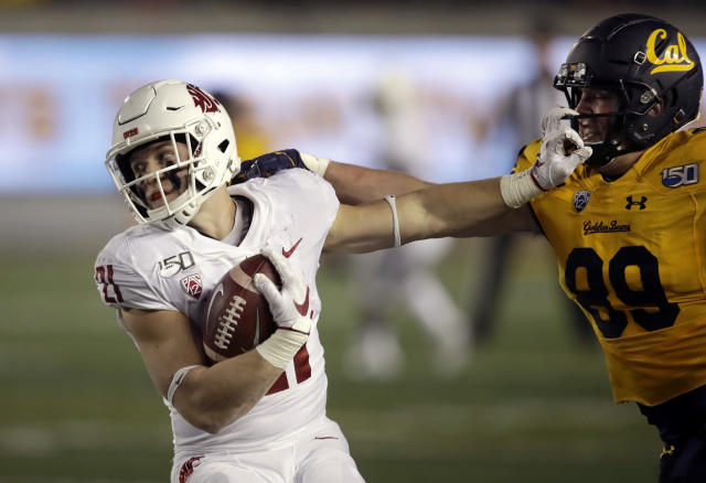 Washington State's Max Borghi, left, straight-arms California's Evan Weaver (89) during the first half of an NCAA college football game Saturday, Nov. 9, 2019, in Berkeley, Calif. (AP Photo/Ben Margot)