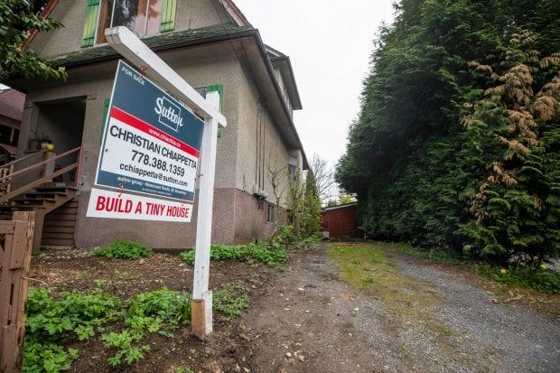 The tiny lot listed for $289,000 in East Vancouver's Commercial Drive area has nine feet of frontage. Shed not included.  (Ben Nelms/CBC - image credit)