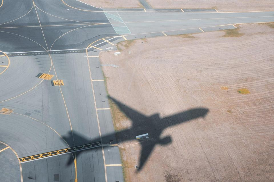 Shadow of airplane taking off from airport
