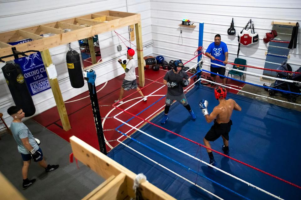 Billy Pocan coaches his boxers during practice at Soaring Eagles Boxing Club, Friday, Aug. 6, 2021, in Green Bay, Wis. Samantha Madar/USA TODAY NETWORK-Wisconsin