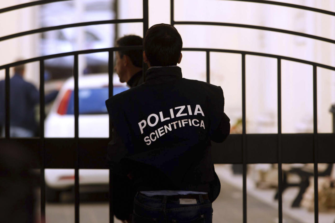 A forensic police officer enters the courtyard of Sant' Apollinare Basilica, in Rome, Monday, May 14, 2012. Indications mounted Monday that the tomb of reputed mobster Enrico De Pedis was to be opened inside the basilica as part of an investigation into one of the Vatican's enduring mysteries: the 1983 disappearance of the teenage daughter of a Vatican employee, Emanuela Orlandi. (AP Photo/Roberto Monaldo, Lapresse) ITALY OUT