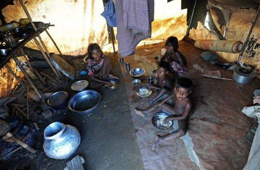 Muslim Rohingya children eat lunch in their tent at the Bawdupha camp for internally displaced people on the outskirts of Sittwe, the capital of Myanmar's western Rakhine state, on November 2. Myanmar's reformist government is under pressure to give Rohingya a legal status as it comes under international scrutiny with warnings that the conflict threatens its democratic transition