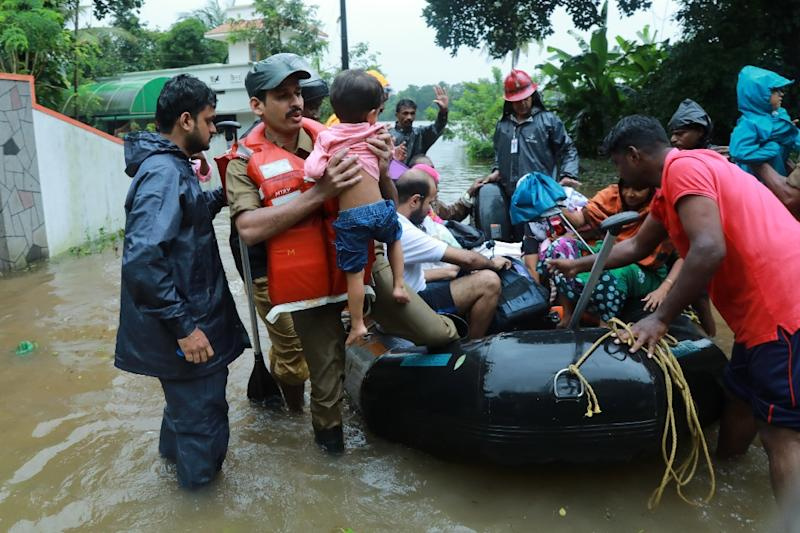 People could be seen paddling lifeboats provided by the armed forces (AFP Photo/-)