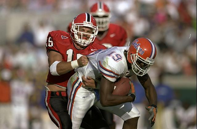 Kirby Smart (L) had 13 interceptions as a player for the Bulldogs. Now he's coaching them in the national title game. (Getty)