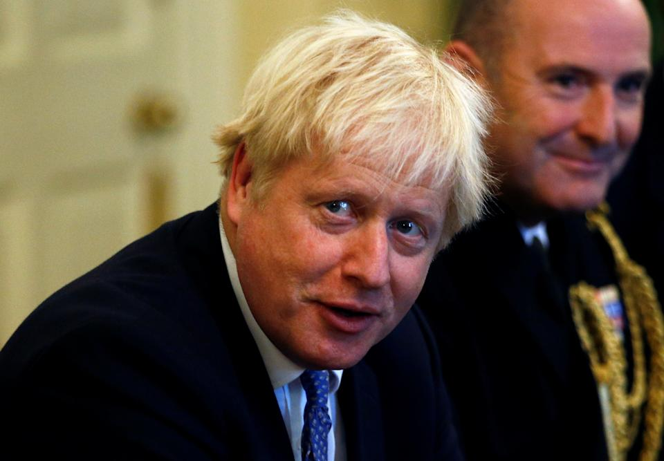 British Prime Minister Boris Johnson attends a roundtable at Downing Street in London, Britain, September 19, 2019. REUTERS/Henry Nicholls/Pool