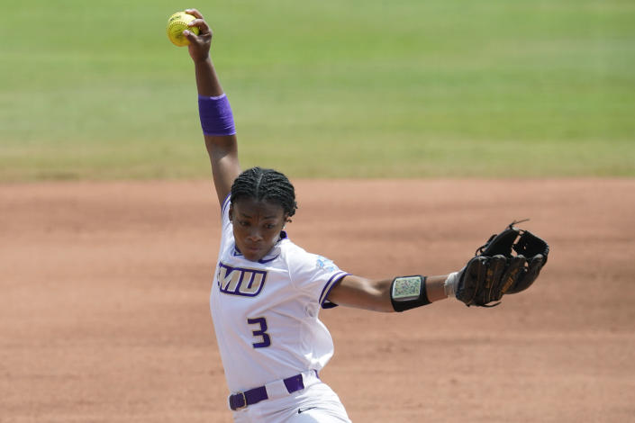 James Madison's Odicci Alexander pitches in the first inning an NCAA Women's College World Series softball game against Oklahoma, Sunday, June 6, 2021, in Oklahoma City. (AP Photo/Sue Ogrocki)