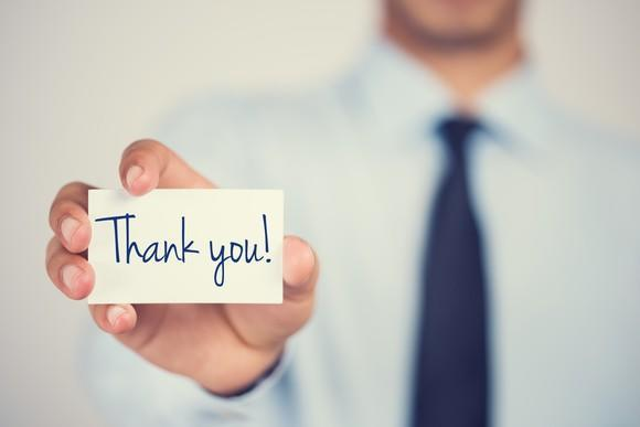 Person holding a thank-you card.