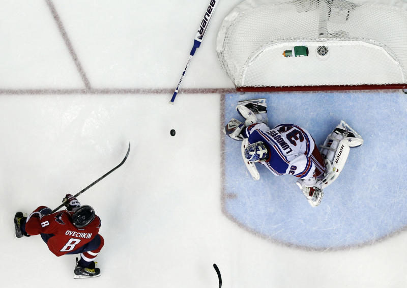 Washington Capitals left wing Alex Ovechkin (8), from Russia, has his shot blocked by a New York Rangers goalie Henrik Lundqvist (30), from Sweden, who had lost his stick, in the third period of Game 5 first-round NHL Stanley Cup playoff hockey series, Friday, May 10, 2013, in Washington. The Capitals won 2-1, in overtime. (AP Photo/Alex Brandon)