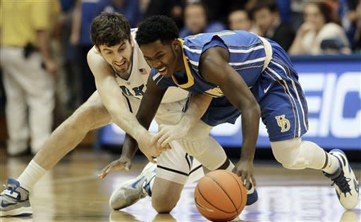 Duke's Ryan Kelly, left, and Delaware's Terrell Rogers reach for a loose ball during the first half of an NCAA college basketball game in Durham, N.C., Saturday, Dec. 1, 2012. (AP Photo/Gerry Broome)