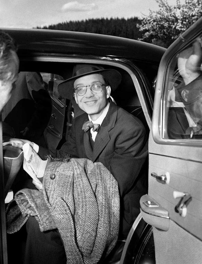 FILE - The May 16, 1953 file photo shows William Oatis, Associated Press correspondent.smiling as he crosses Czech border into American sector of West Germany at Waidhaus after his release from a Czech prison.  Of some 240,000 unlawfully jailed in Czechoslovak Republic, Oatis was the only Western reporter. He was sentenced to 10 years in a communist prison on trumped-up espionage charges. (AP Photo/Heinrich Sanden/Albert Riethausen)