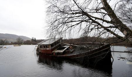An old boat sits in Loch Ness, Scotland, Britain March 8, 2019. REUTERS/Russell Cheyne