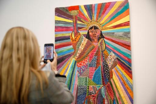A visitor snaps Pacita Abad's 'L.A. Liberty', a work by an American-Filipino artist renowned for merging�traditional textiles with contemporary painting