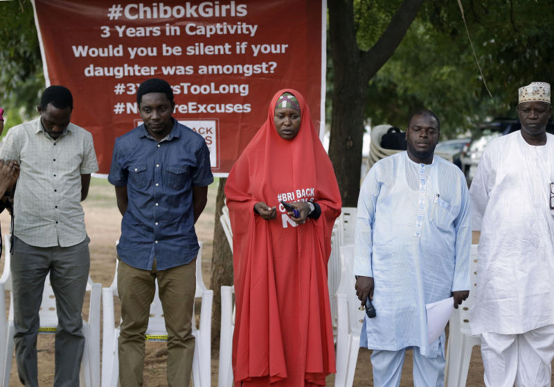 Campaigners observe a minute silent for the remaining Kidnapped schools during their daily sit outs in Abuja, Nigeria. Tuesday. May 9, 2017. One of the Chibok schoolgirls kidnapped by Boko Haram in 2014 and who had the opportunity to be released on Saturday chose to stay with her husband, Nigeria's president spokesman said Tuesday. Garba Shehu said that originally they had been negotiating the release of 83 girls, but one said she wanted to remain. (AP Photo/Sunday Alamba)