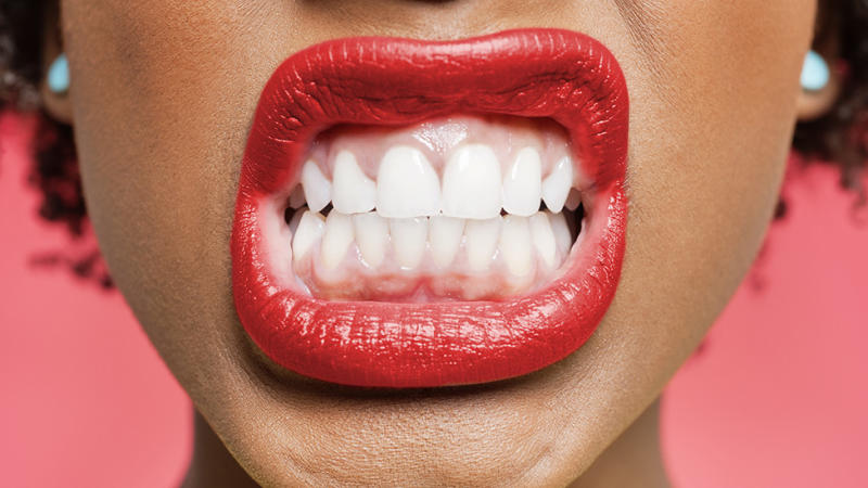 Woman grinds teeth bruxism coronavirus