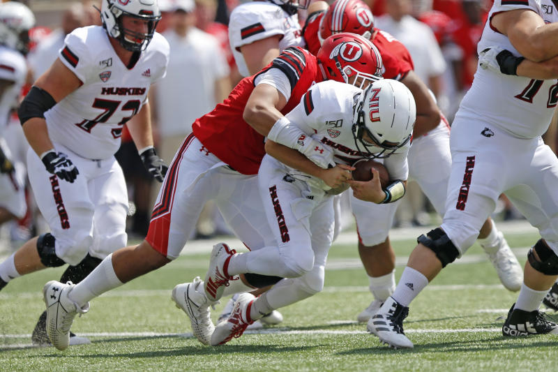 Utah defensive end Bradlee Anae, left, sacks Northern Illinois quarterback Ross Bowers, right, in the second half of an NCAA college football game Saturday, Sept. 9, 2019, Salt Lake City. (AP Photo/Rick Bowmer)