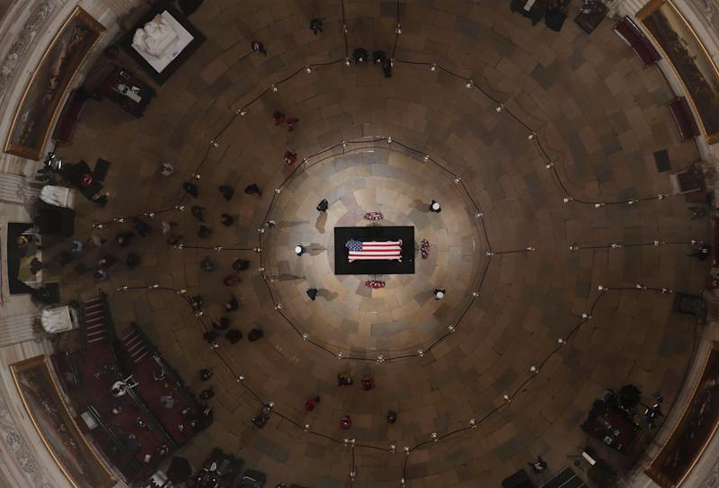 Members of the public are seen inside the Capitol Rotunda as former President George H.W. Bush lies in state on Wednesday ahead of his memorial service. (Photo: ASSOCIATED PRESS)