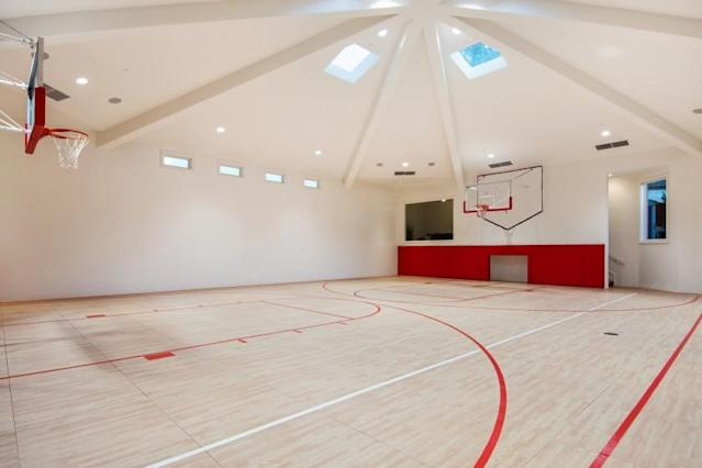 """A basketball gymnasium with a viewing box is among features found at the Westlake Village home of Lakers star Anthony Davis. The 2.33-acre estate is new for sale at $7.995 million. <span class=""""copyright"""">(Jeff Elson)</span>"""