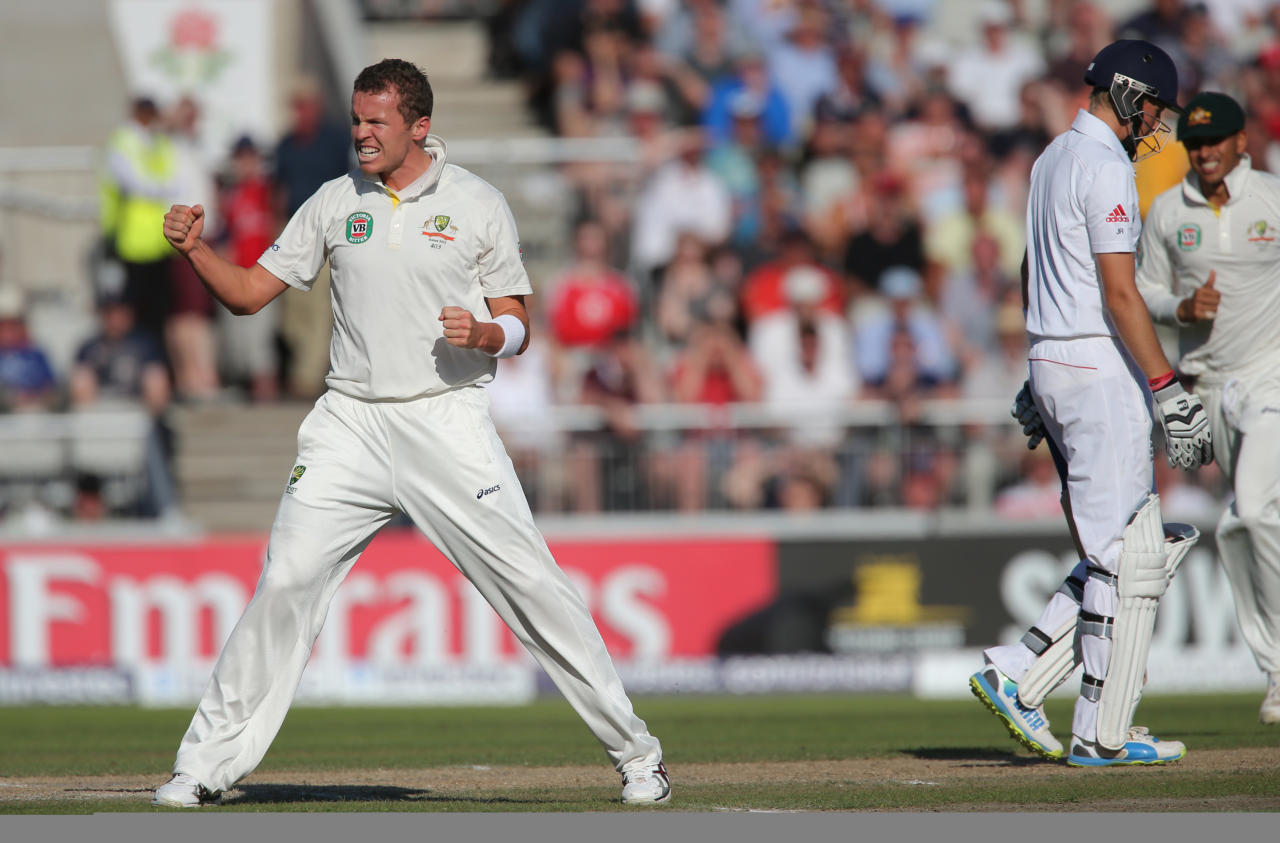 Australia bowler Peter Siddle celebrates taking wicket of England batsman Joe Root during day two of the Third Investec Ashes test match at Old Trafford Cricket Ground, Manchester.
